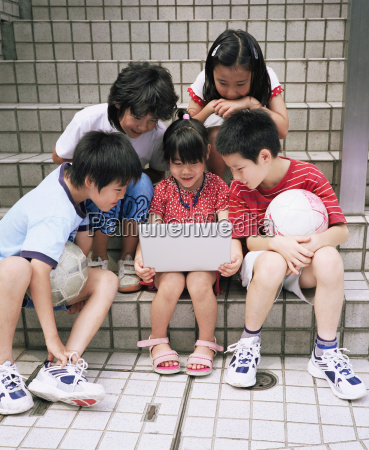 group of children with laptop computer