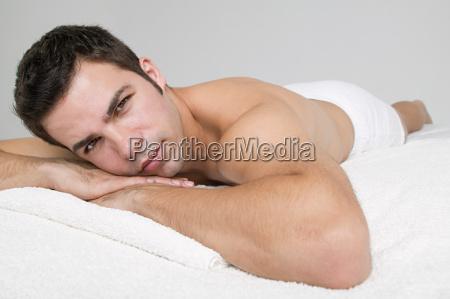 man lying on massage table
