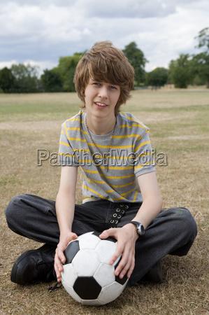 teenage boy with a football