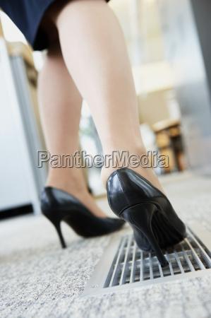 businesswoman with heel stuck