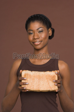 young woman holding a loaf of