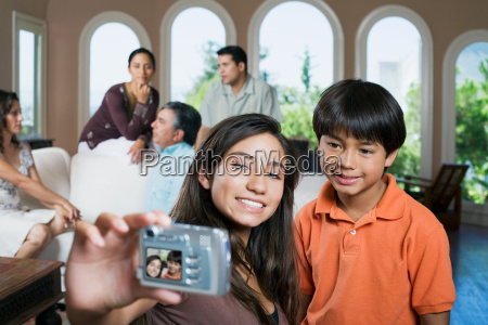 girl and boy with camera at