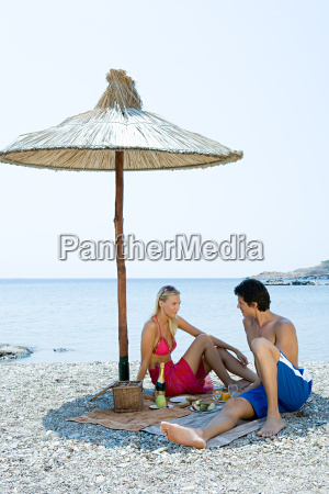 couple having a picnic by the