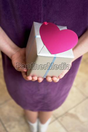 girl holding gift behind her back