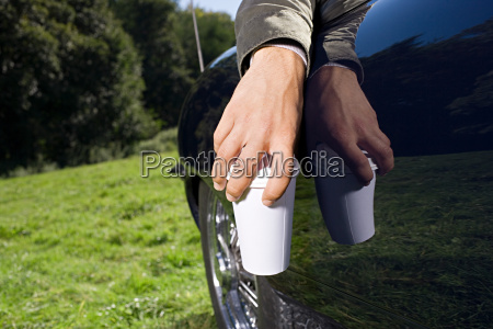 hand holding coffee cup
