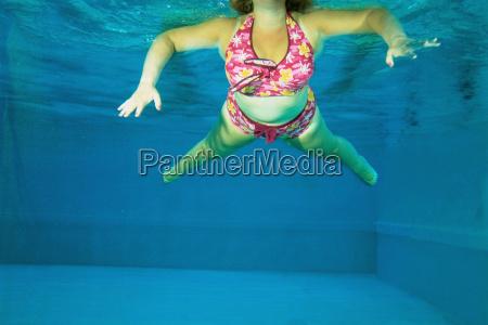 a woman dancing underwater