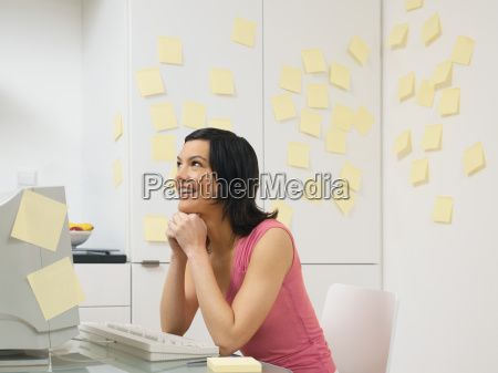 woman in kitchen with adhesive notes