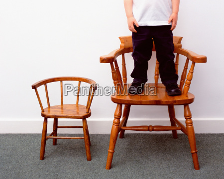 boy and little and large chairs
