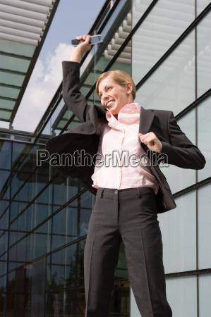 businesswoman jumping outdoors