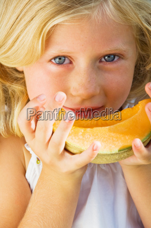 girl with a slice of melon