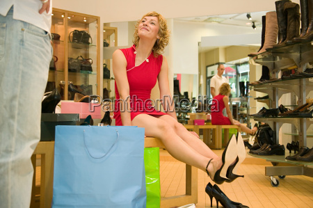 woman looking pleased with shoes