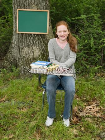 portrait of a girl sat a