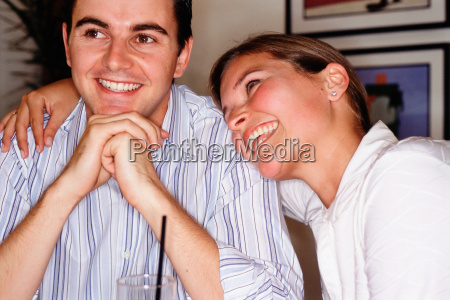 happy young couple in bar
