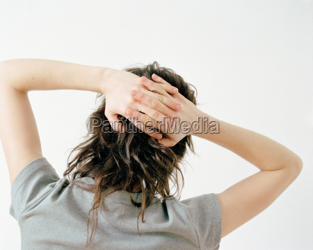 woman with hands behind head