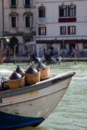 wine containers on boat grand canal