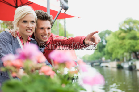 couple looking at view on canal