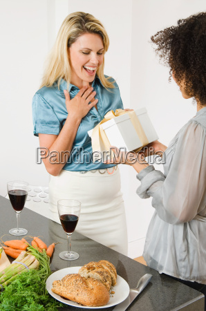 a woman giving a friend a