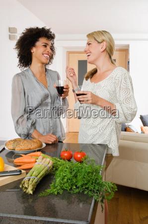 two women having red wine