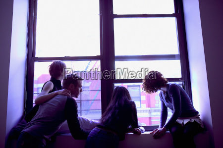 silhouetted people at window