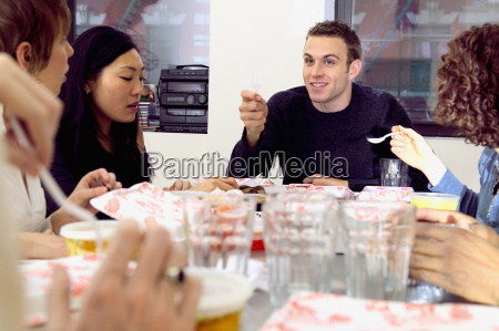 friends eating fast food at table