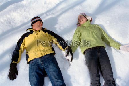 couple lying in snow