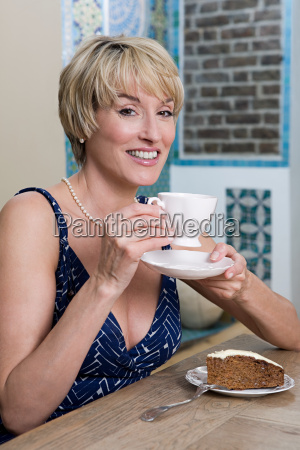 woman in cafe with cup of