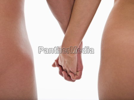 nude couple holding hands
