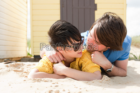 young couple by a beach hut