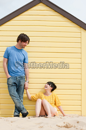couple by a beach hut