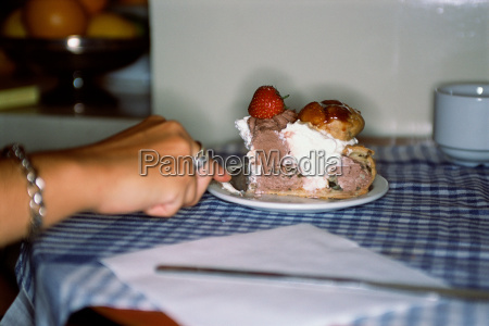 woman eating a cake in cafe
