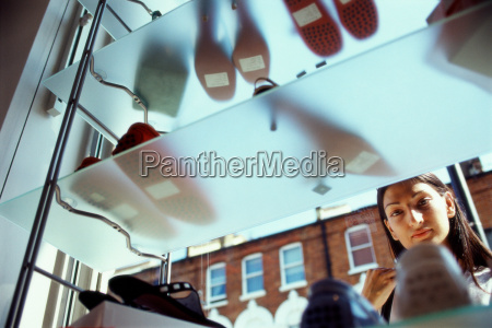 woman window shopping for shoes