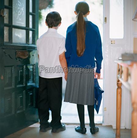 school children standing in doorway