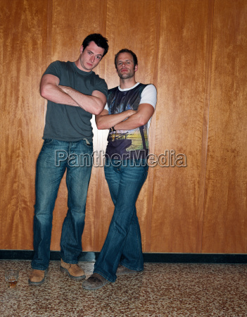 two men with arms crossed