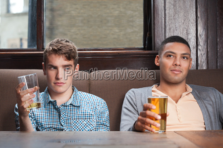 two young men in bar