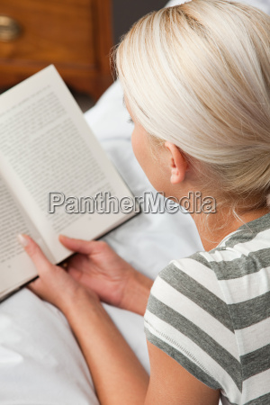 young woman reading book high angle