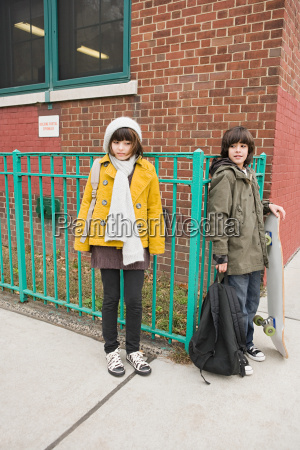 girl and boy outside school