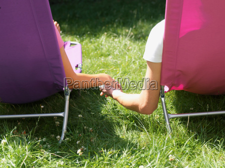 young couple relaxing on lounge chairs