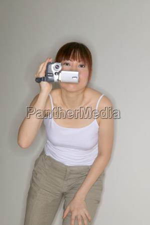 woman using a video camera