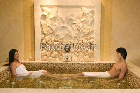 young couple relaxing in hot tub