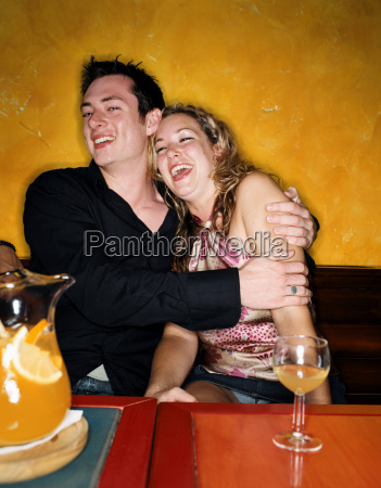 couple hugging in a bar
