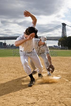 two men playing baseball game