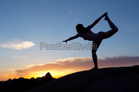 young woman in dancer pose in