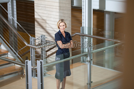 businesswoman on stairwell