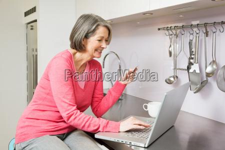 mature woman using internet banking