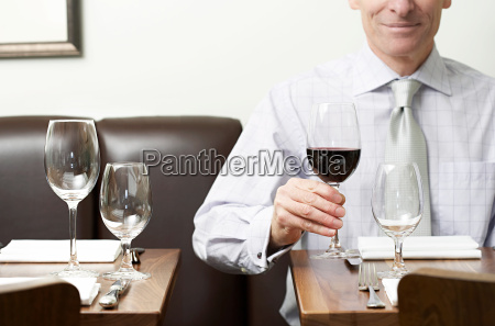 a man holding a glass of