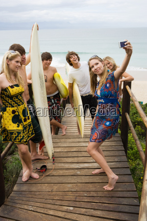 surfer friends with camera