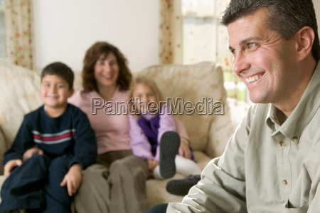 father laughing with his family