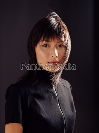 young asian woman with windswept hair