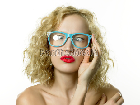 young woman wearing blue glasses cross
