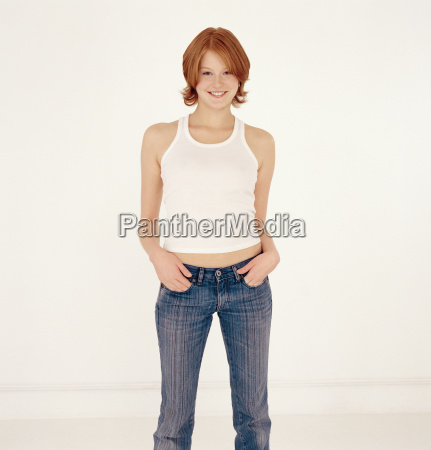 young woman with hands in pockets